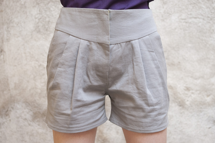Grey Papercut Pleated Shorts: Front